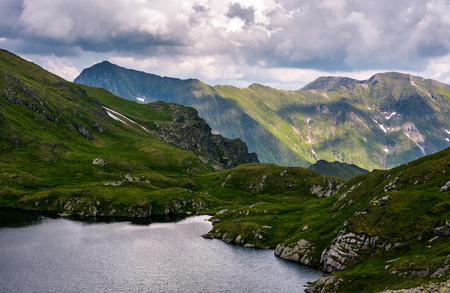 glacier lake Capra in Southern Carpathians. beautiful summer landscape in Fagaras Mountains of Romania