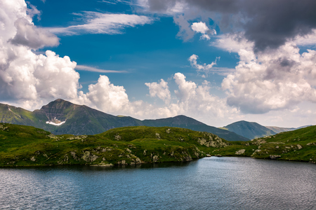 glacier lake Capra in Southern Carpathians. beautiful summer landscape with gorgeous sky in Fagaras Mountains of Romania