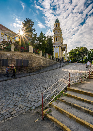 Uzhgorod, Ukraine - Jun 11, 2017: people go uphill to the Greco Catholic cathedral. everyday life in the central part of the beautiful old down in the morning