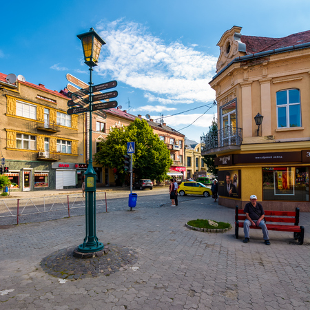 Uzhgorod, Ukraine - Jun 11, 2017: streets of the old tow on summer morning. everyday life in the central part of Uzhgorod