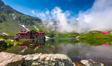 Transfagarasan road, Romania - Jun 26, 2017: lake Balea in Fagaras mountains in foggy weather. amazing summer landscape of one of the most visited landmarks in Romania Stock Photo