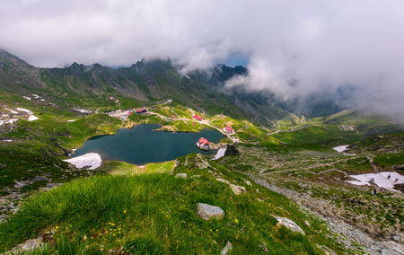 mountain lake Balea view through the clouds. amazing summer landscape of one of the most visited landmarks in Romanian Fagarasan mountains Stock Photo
