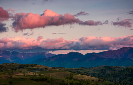 mountain ridge under the pink sky at dawn. lovely springtime landscape Stock Photo