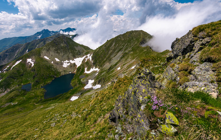 Dramatic scenery with snow near glacier in Fagaras mountains