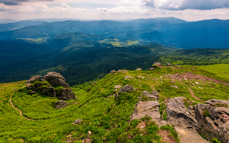 footpath among huge rocks on the edge of a hill. beautiful valley view from the top Stock Photo - 91904901