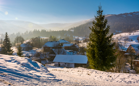 village in mountainous area in winter carpathian landscape. location Pylypets, Ukraine Stock Photo