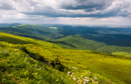 grassy slopes of Carpathians before the storm. beautiful mountainous landscape in summertime Stock Photo