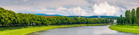 longest linden alley in europe. Summer landscape on the river embankment in Uzhgorod, Ukraine. Stock Photo