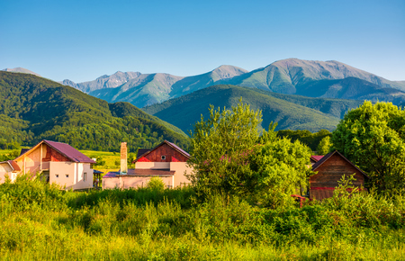 village in Fagaras mountains of Romania. Lovely rural scenery in evening Stock Photo