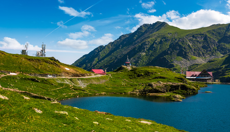 Transfagarasan road, Romania - Jun 26, 2017: lake Balea in Fagaras mountains on a bright sunny day. amazing summer landscape of one of the most visited landmarks in Romania Editorial