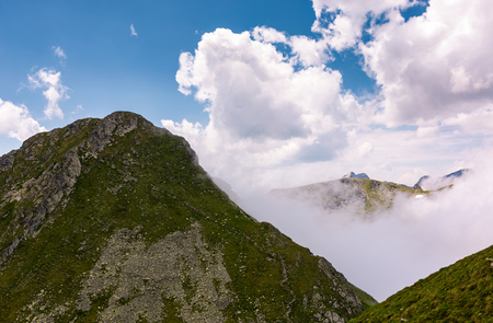 mountain ridge on a cloudy day. beautiful nature summer scenery in Fagaras mountains, Romania. concept of outdoor activity in any weather condition. lovely travel background Stock Photo