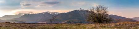 panorama of the Borzhava mountain ridge with snowy tops. wonderful springtime landscape of Ukrainian Carpathians Stock Photo