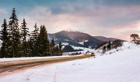 road turnaround near the forest in snowy mountains. winter scenery in Carpathian mountains Stock Photo