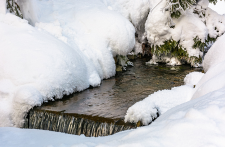 brook with cascades in winter. lovely nature background