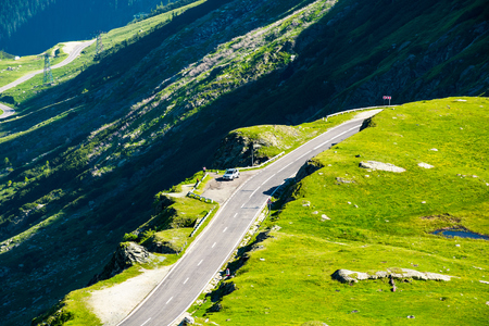 Transfagarasan mountain road in the valley, view from above. beautiful transportation scenery in summertime Stock Photo