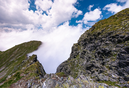 beautiful cloudscape over the cliffs of Fagarasan mountain ridge. lovely nature background on a summer day