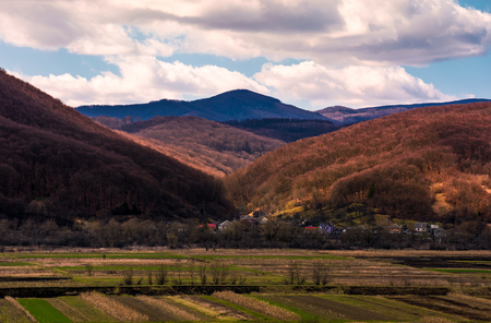 village in mountainous rural are. beautiful countryside landscape in springtime. Cloudy afternoon in Carpathians Stock Photo