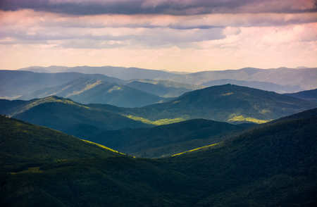 forested rolling hills of Carpathian mountains. gorgeous nature scenery on a cloudy summer day Stock Photo