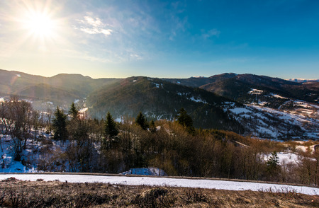 sunny day in Carpathian mountains. lovely winter landscape with small amount of snow Stock Photo