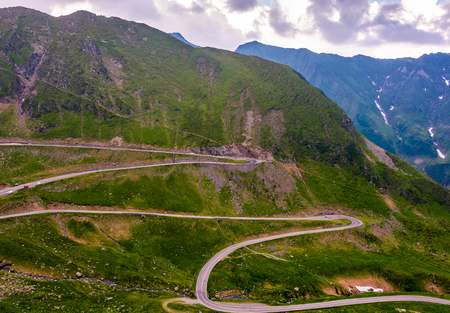 serpentine of Transfagarasan road in mountains. lovely transportation background Stock Photo