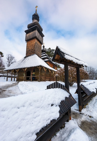 Uzhgorod, Ukraine - JAN 15, 2017: old orthodox wooden church in winter. location Museum of Folk Architecture and Life. Editorial