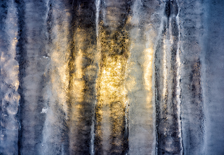 sun behind the ice wall. beautiful winter background with fine frosted textures of the cold surface
