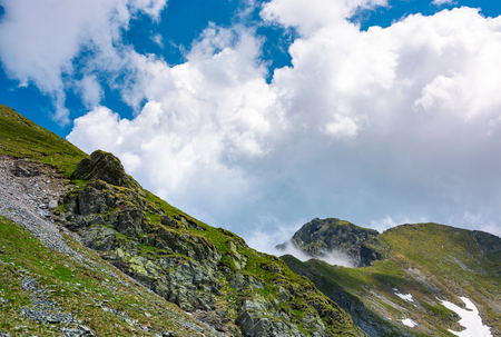 clouds over the mountain ridge with rocky cliffs. beautiful summer scenery of Fagaras mountains