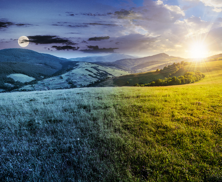 time change concept over the grassy meadow in mountains. beautiful summer countryside under the gorgeous sky, sun and moon