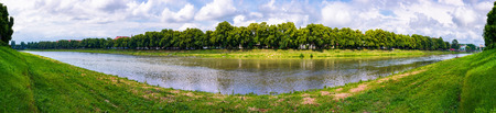 panorama of longest linden alley in europe. Summer landscape on the river embankment in Uzhgorod, Ukraine. Stok Fotoğraf - 95760122