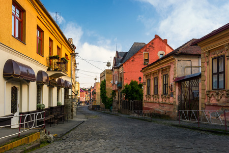 empty street of old town on summer morning. cobblestone pavement on the ground. beautiful scenery with architecture of Austria-Hungary times. Stock Photo - 95785219