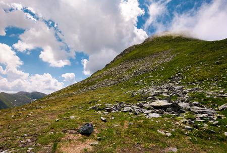 gorgeous cloudscape over the Fagaras mountains. beautiful summer landscape of Romania