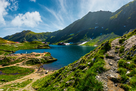 lake Balea in Fagaras mountains on a bright sunny day. amazing summer landscape of one of the most visited landmarks in Romania