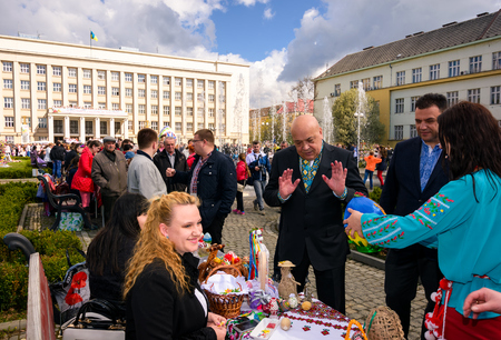 Uzhgorod, Ukraine - April 07, 2017: Celebrating Orthodox Easter in Uzhgorod on the Narodna square. Hennadiy Moskal, the governor of TransCarpathian region, rejects the Easter egg presents Editorial