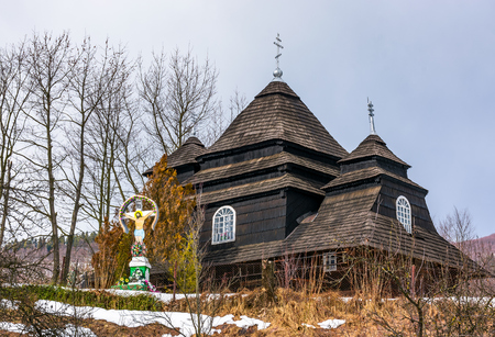 Uzhok, Ukraine - February 25, 2017: Church of the Archangel Michael. old wooden building in Carpathian mountains in winter Editorial