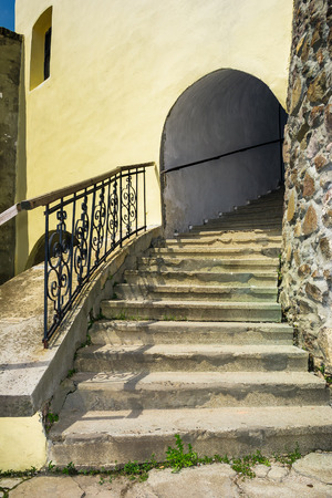 steps upstairs in to the clock tower of Palanok Castle. Old fortification now serves as the museum and is popular tourist landmark