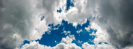beautiful blue hall on an overcast sky. dark grey rainy clouds open