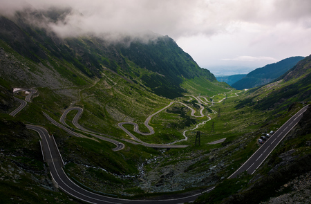Transfagarasan road view from the cliff. dramatic moment before the storm Stock Photo