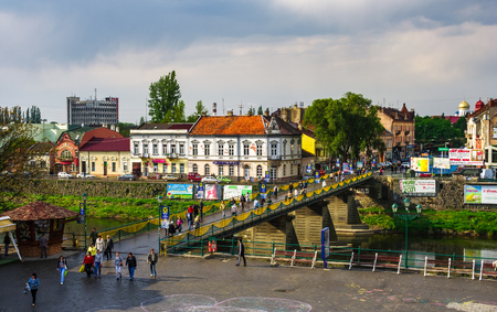 Uzhgorod, Ukraine - April 29, 2011: bird eye view of Uzhgorod town. Pedestrian bridge and old architecture on Shandor Petefi square.