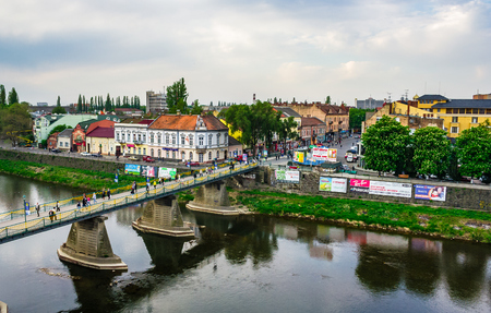 Uzhgorod, Ukraine - April 29, 2011: bird eye view of Uzhgorod town. Pedestrian bridge and old architecture on Shandor Petefi square on a rainy day Editorial