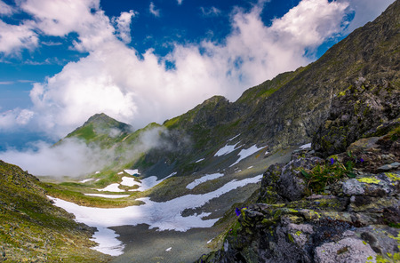 mountain ridge among the clouds. beautiful summer landscape with peak in the far distance