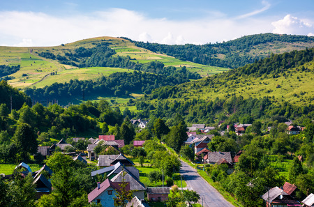 road through village in Carpathian mountains. bird eye view of beautiful rural scenery in summertime 版權商用圖片 - 97998785
