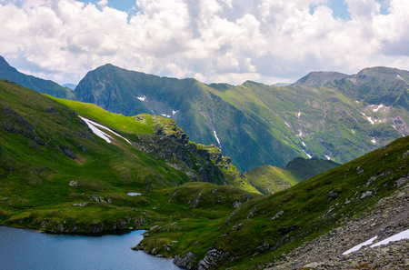 lake Capra in Fagarasan mountains of Romania. beautiful summer scenery on a cloudy day. Popular tourist destination for Hiking. 스톡 콘텐츠