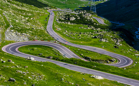 serpentine road in Fagarasan mountains. lovely transportation background. Popular tourist destination of Romania