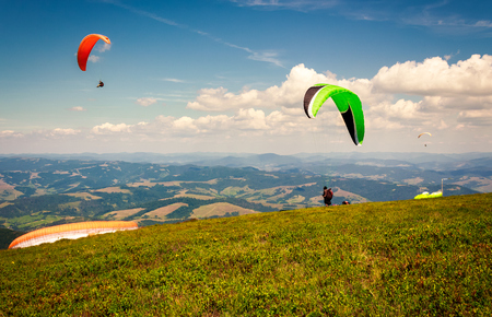 Skydiving  flying over the mountains. parachute extreme sport Stock Photo - 97998790