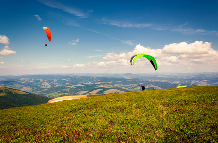 Skydiving  flying over the mountains. parachute extreme sport Stock Photo - 98005874