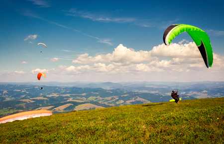Skydiving  flying over the mountains. parachute extreme sport Stock Photo - 98005879