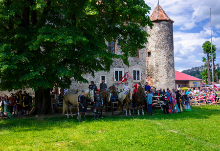 Chynadiyovo, Ukraine - May 27, 2017: medieval culture festival Silver Tatosh. Location St. Miklos Castle. Knights on horses getting ready for action