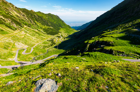 transfagarasan road in mountains of Romania. gorgeous view of the landscape from the edge of a hill. serpentine road with is winding down the valley Stock Photo