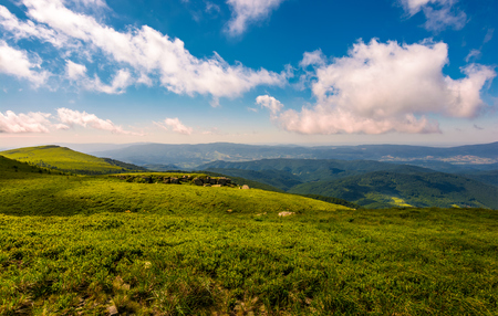 fluffy clouds rolling above the mountain meadow. beautiful landscape on high altitude in summer Stock Photo