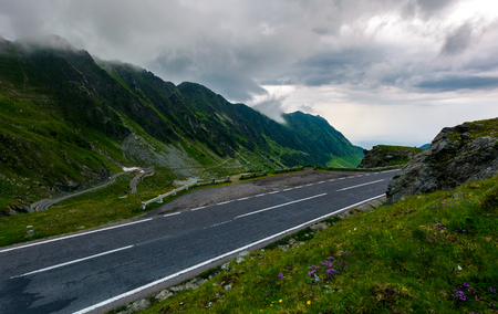 Transfagarasan road on a rainy day. dangerous driving concept. view from the side of the road